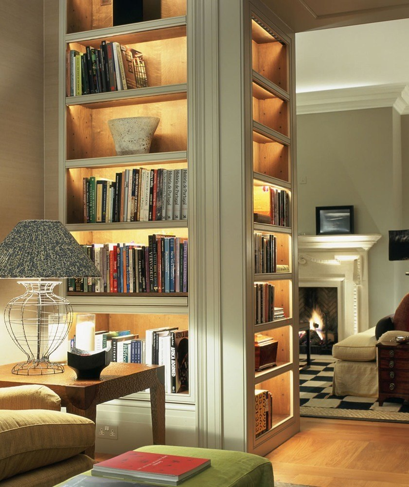 A comfortable raw wood bookcase will fit harmoniously in a small room.