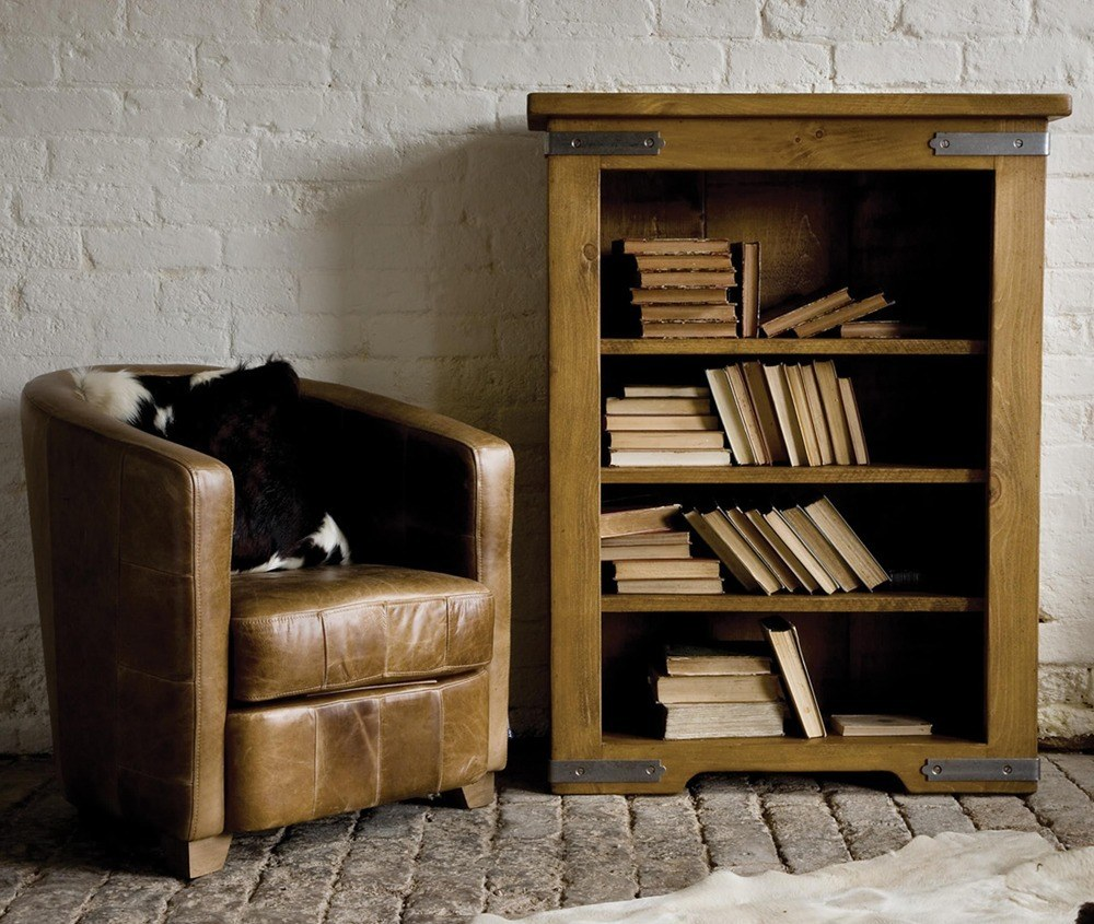 Raw wood bookcase for books and other needs can significantly save space in the room.