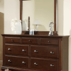 A tall dark brown dresser is necessary and comfortable piece of furniture.