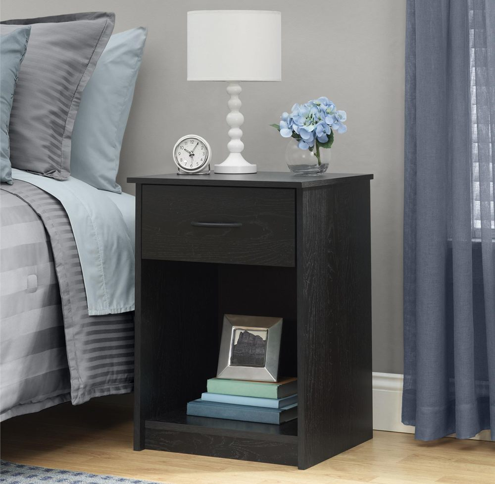 A dark mahogany nightstand can look like a bedside chair or other usual thing.