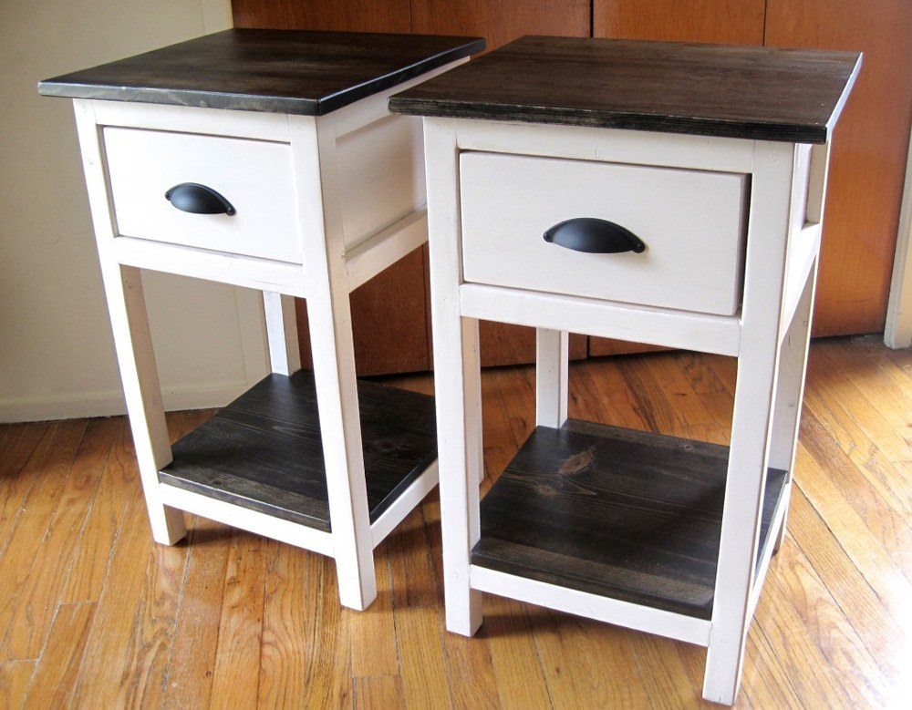 A white nightstand with dark wood top can look like a bedside chair or other usual thing.