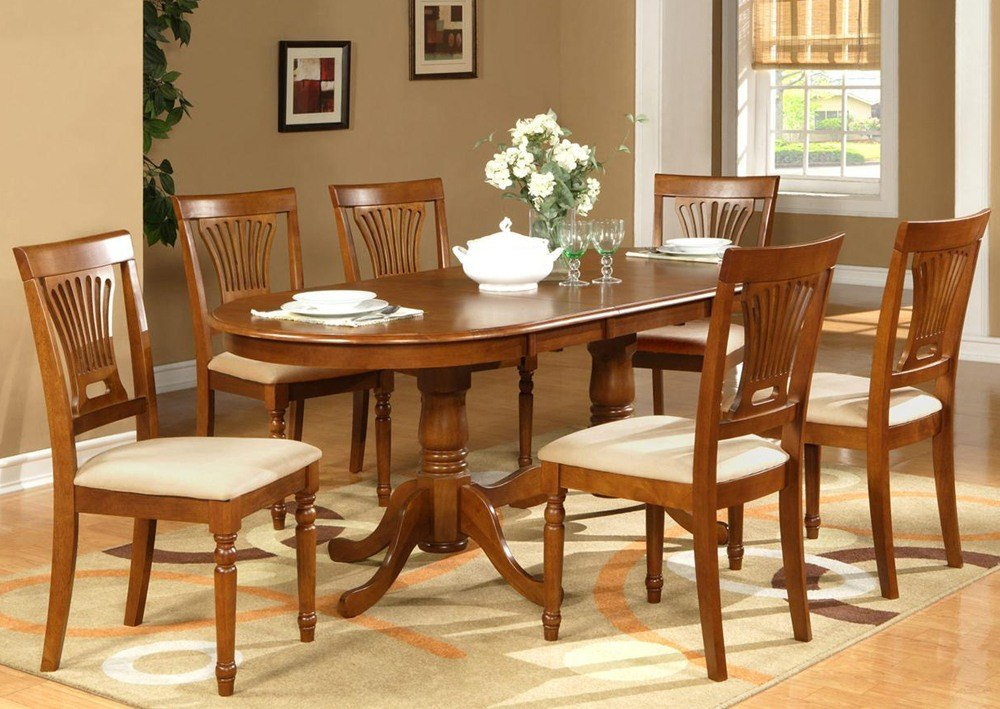 Solid oak oval dining table is a good idea for the narrow rooms.