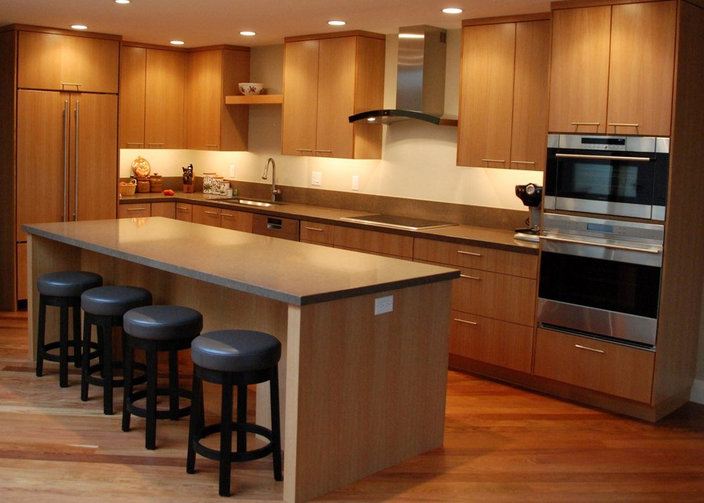 Cherry Wood Kitchen With Black Bar Stools