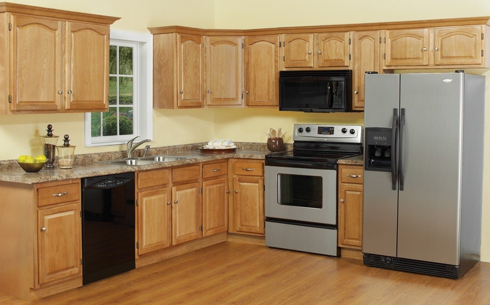 Nowadays modern cathedral kitchen cabinets in dark colored wood were replaced by colored ones.