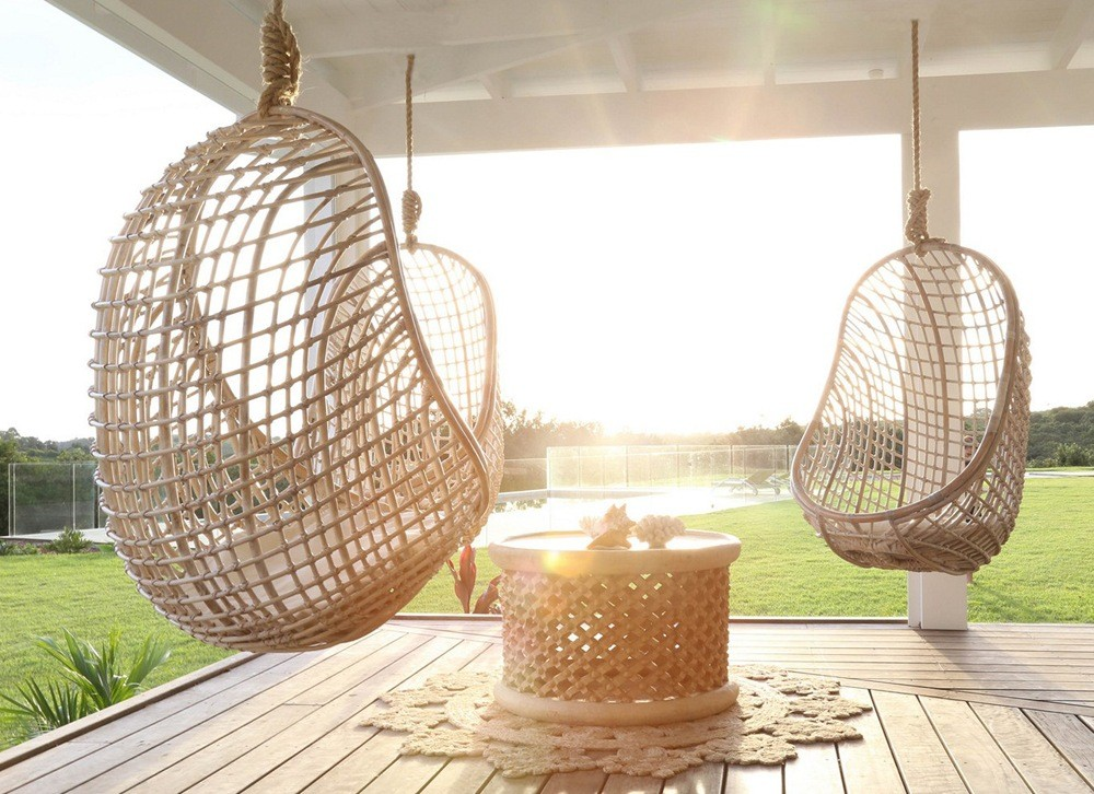 Unique Outdoor Chairs have the shape of hemisphere, which is made of woven rattan covered with the cushion.