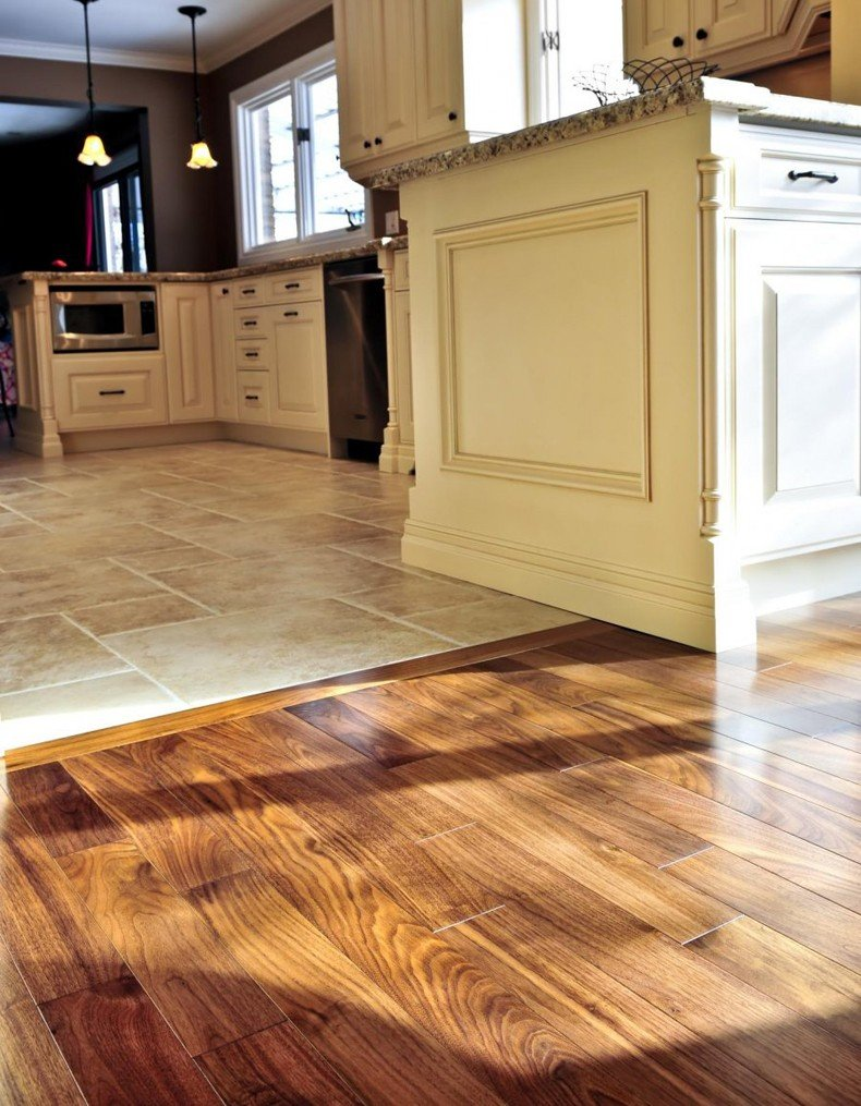 Hardwood to tile transition ideas difference is in the method of apply on the floor.
