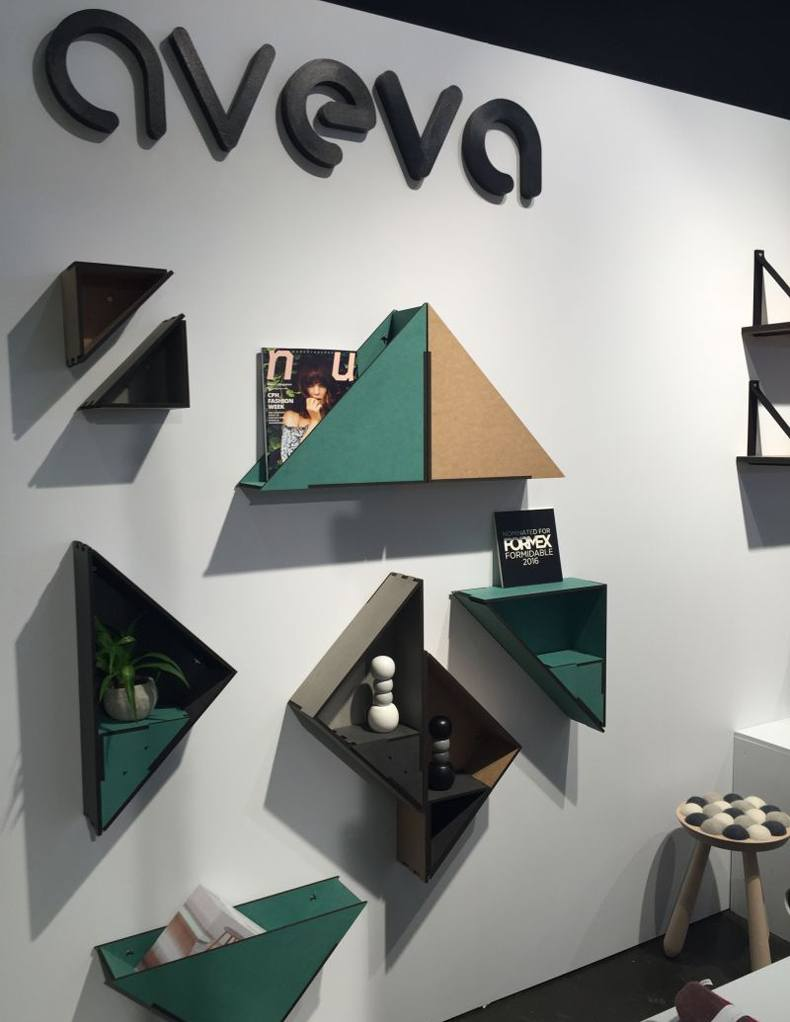 The triangle shaped bookshelf with a quirky contemporary twist has a name the Flip Shelf.