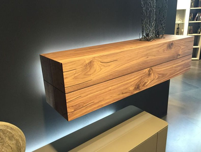 Real wood floating shelves are the most effective and practical way to use the space.