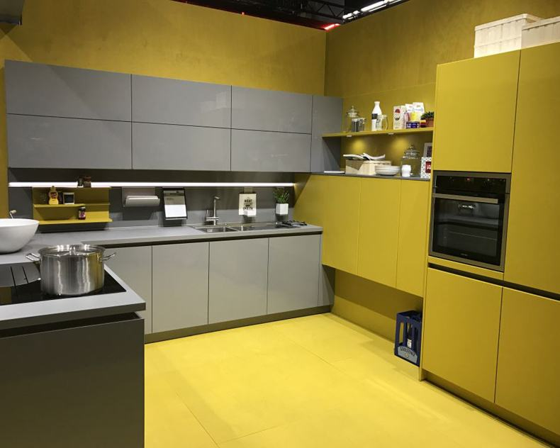 There are dozens of kinds of grey and yellow kitchen cabinets made of wood.