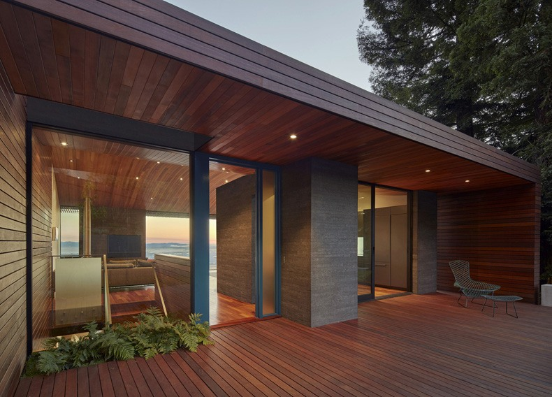 Wooden porch roof makes the terrace a perfect viewing deck overhang ideas for admiring the surroundings and bay in full splendor.