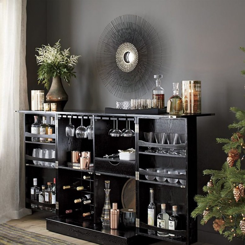 Steamer trunk bar cabinet fits perfectly in small apartments.