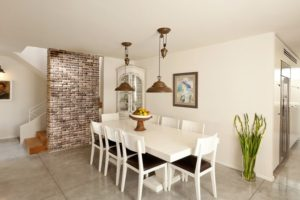 White Dining Table Brick Wall