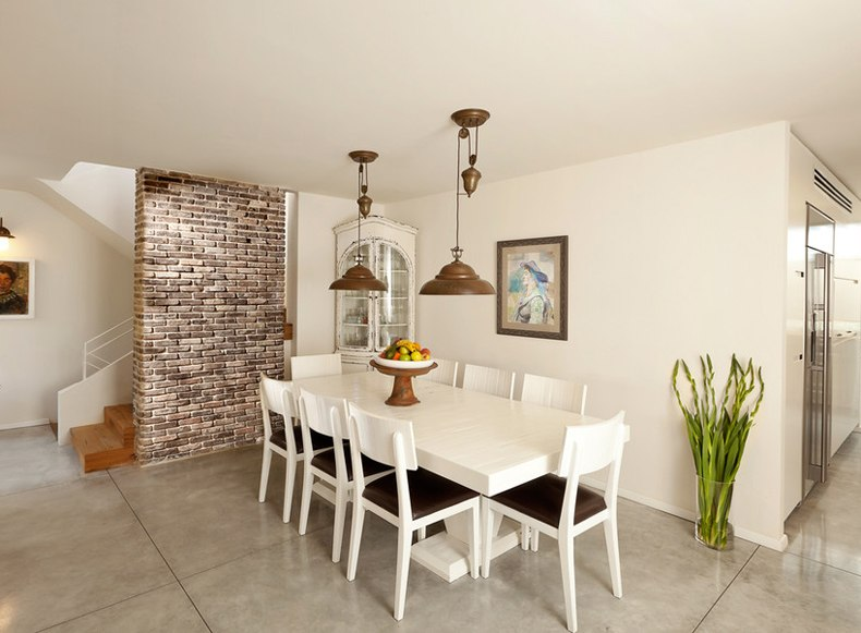 Dining Room With Brick Wall