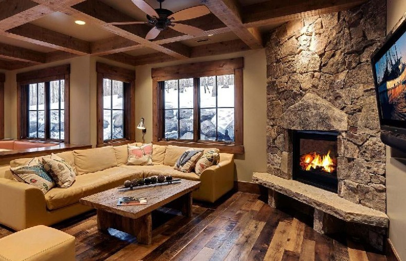 Corner Rocks Fireplace For a Mountain Living Room Featuring Hardwood Floors