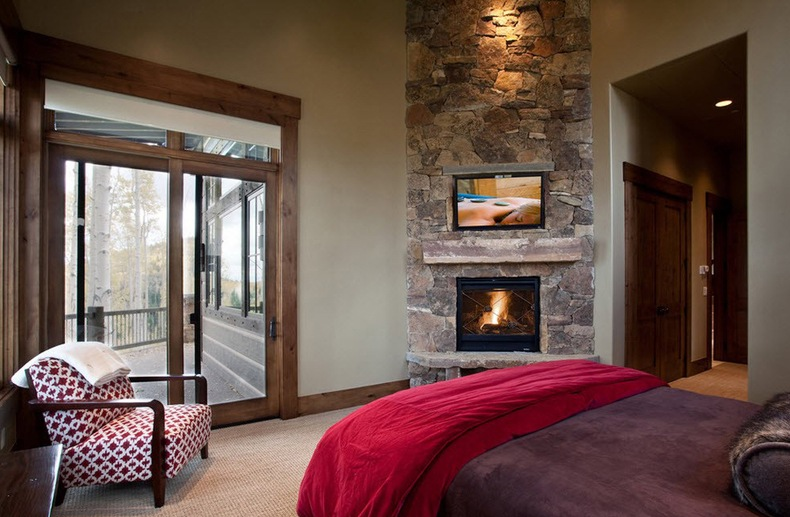 Fireplace From Stone Designed For Corner in the Bedroom