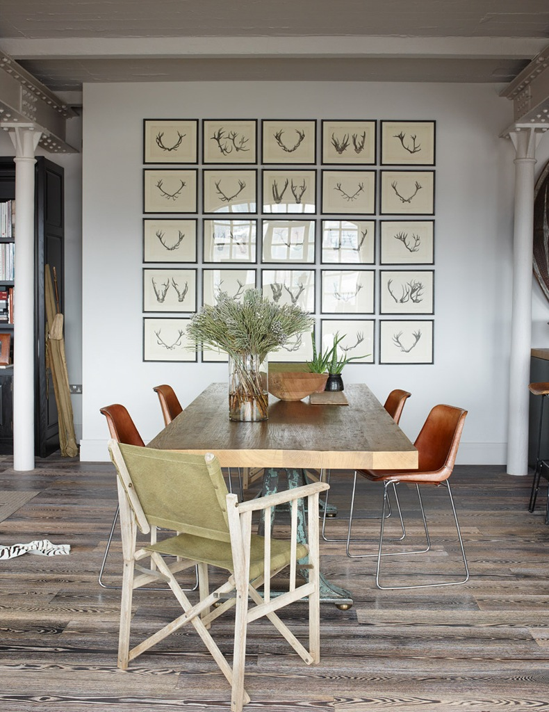 Industrial Loft Dining Area With a Collection Of Framed Pictures