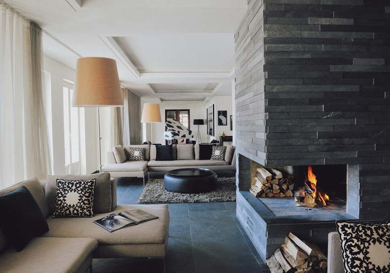 Large Living Room Featuring a Corner Fireplace