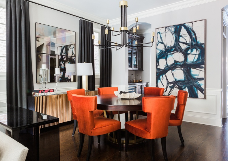 Choose massive marble-top table mixed with orange dining chair cushions.