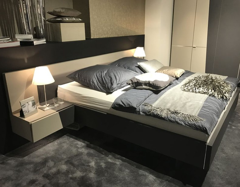 Floating Bed Design With Nighstand And Small Table Lamps
