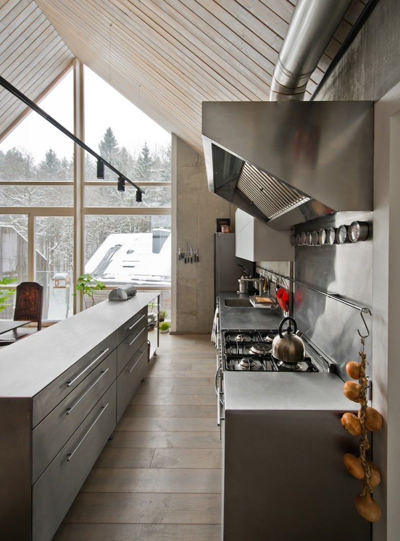 Lithuanian House Features A Kitchen With An Industrial Hood