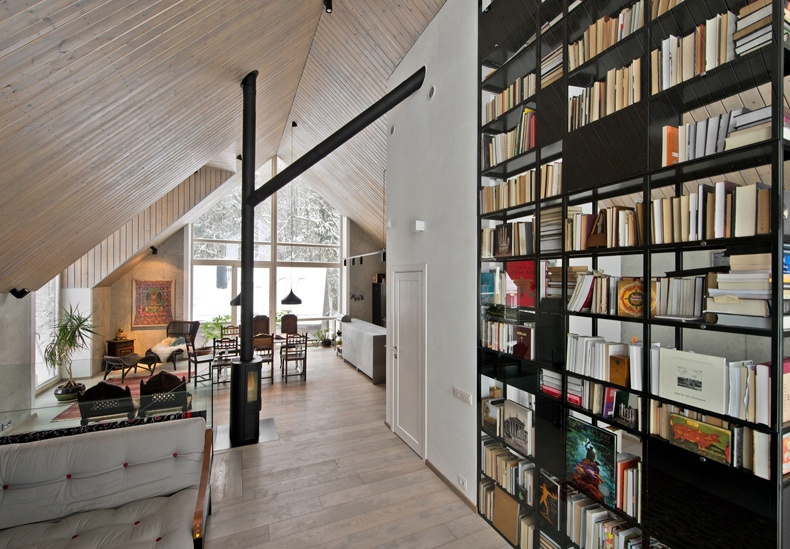 Lithuanian House Features A Tall Bookcase With A Metal Frame