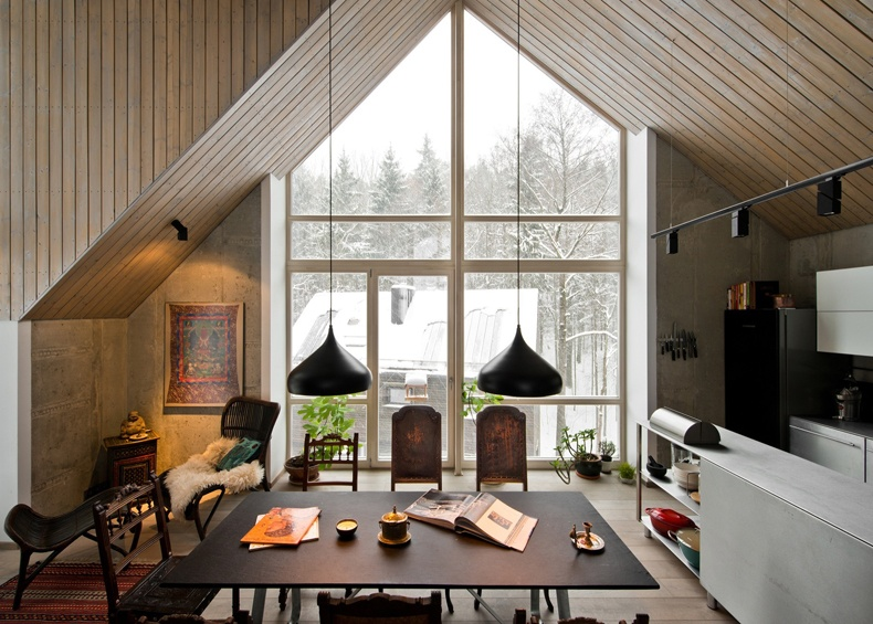 Lithuanian House Features A Warm And Cozy Dining Space With A Nice View
