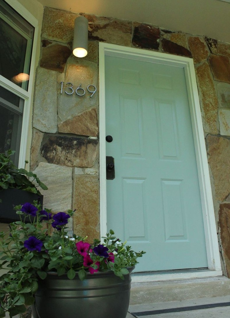 Sage green front door and give the welcoming thing every time when you come back home.