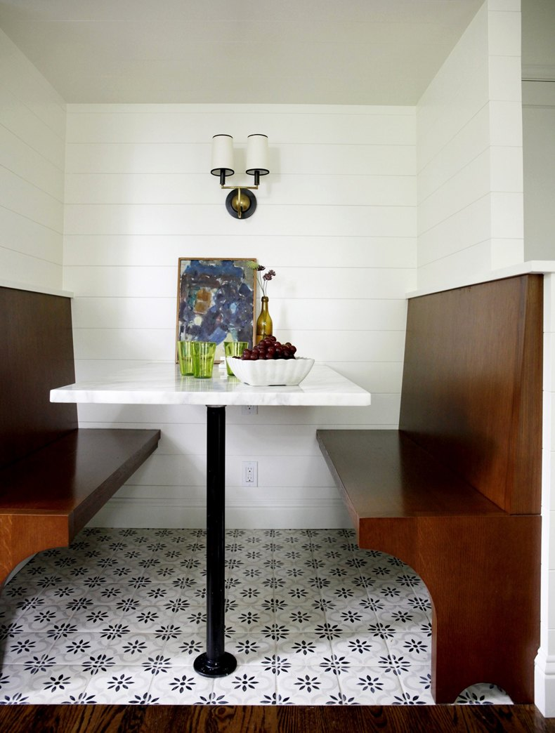 Choose the tulip table with bench to make a perfect kitchen breakfast nook in room full of square cabinets.