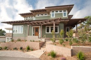 Designers propose to add some soft sage green exterior house paint.