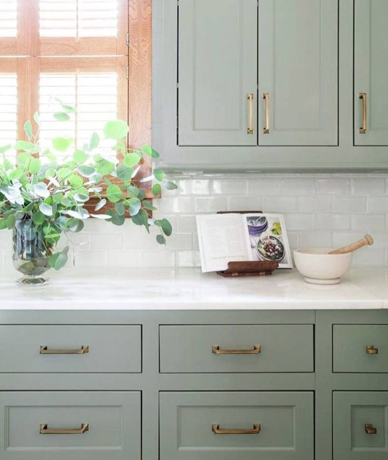 Sage green kitchen cabinets will look cool calming in your space.