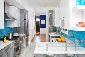 Galley Kitchen In Bright Tile Backsplash