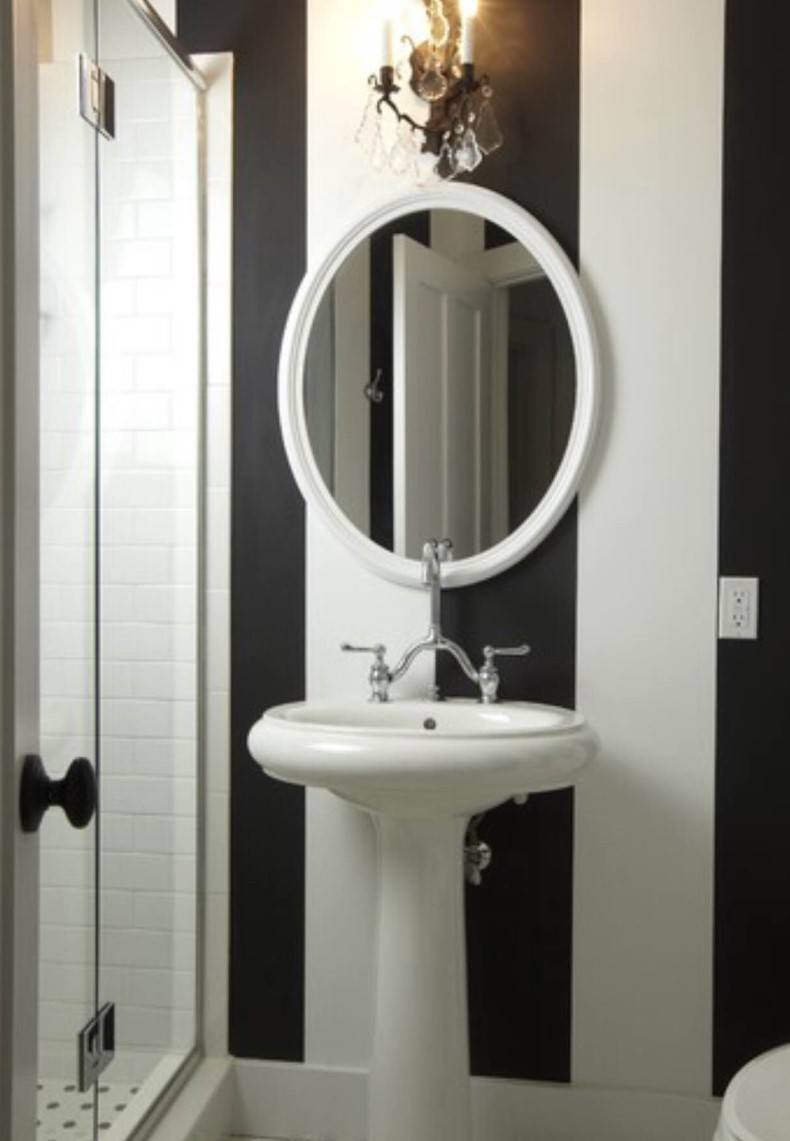 All your guests will like black and white striped bathroom!