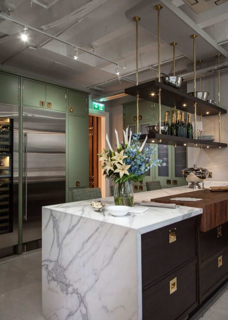Kitchen With Brass Accents And Marble