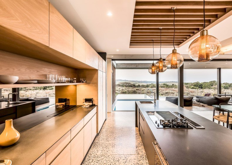 Large modern kitchen has something magic that attracts family members and friends.