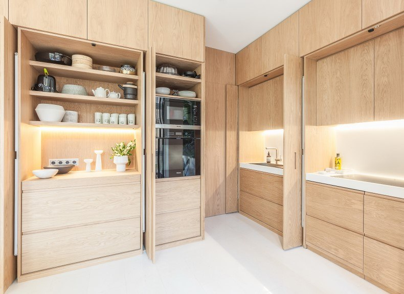Small Wood Kitchen With Compact Behind Doors